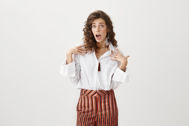 Surprised attractive woman gasping shocked