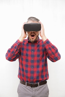 Surprised bearded man in vr headset