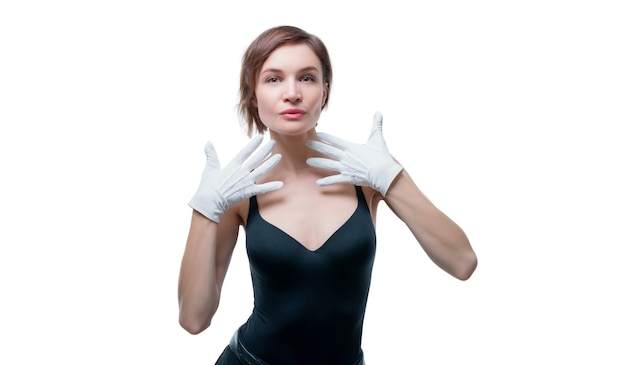 Surprised beautiful young woman in white gloves posing in the studio on a white