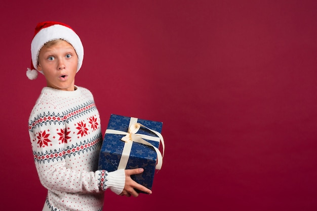 Surprised boy with christmas present