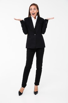 Surprised business woman standing isolated