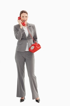 Surprised businesswoman talking on the phone