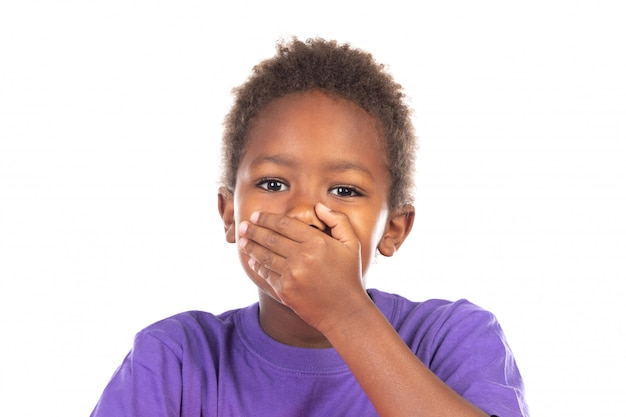 Surprised child covering his mouth