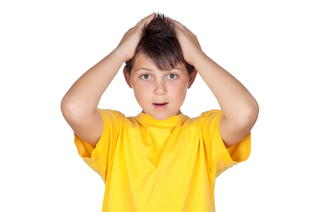Surprised child with yellow t-shirt isolated on white background