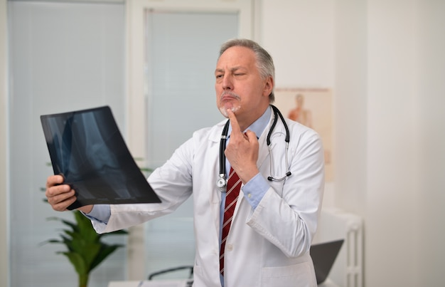 Surprised doctor looking at a radiography