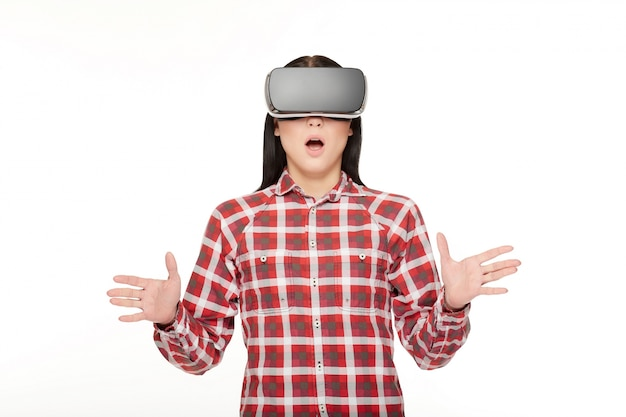 Surprised emotional woman in vr gesturing by hands.