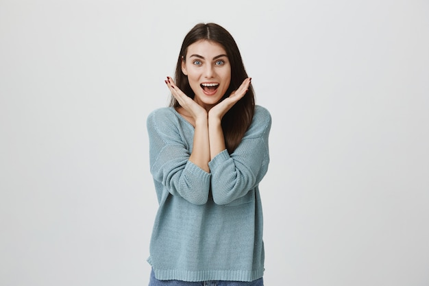 Surprised and excited woman smiling astonished