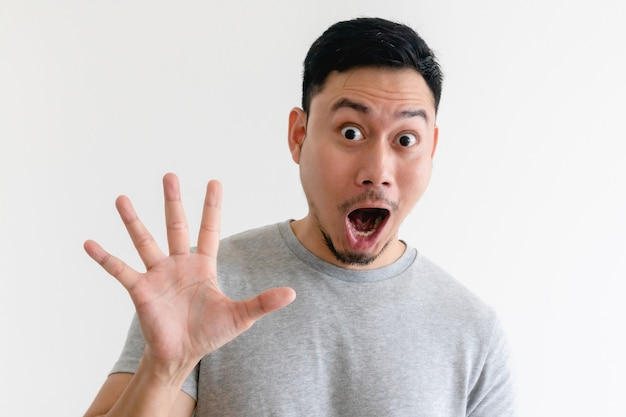 Surprised face asian man making number hand sign on isolated white background.