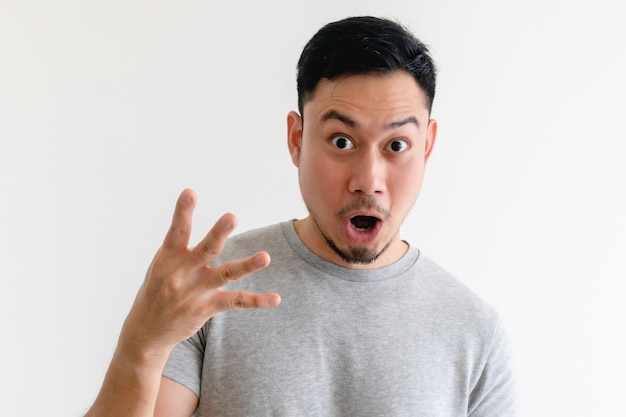 Surprised face asian man making number hand sign on isolated white space.