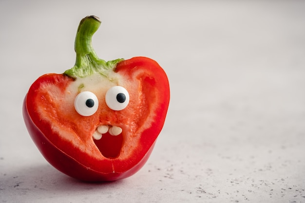 Surprised funny pepper with a candy eyes