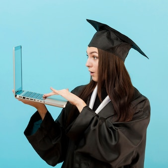Surprised girl holding laptop