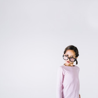 Surprised girl in glasses