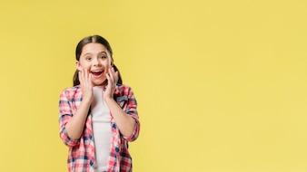 Surprised girl standing in studio
