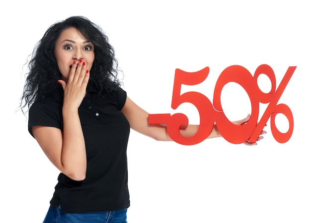 Surprised girl with the red sign -50% sale.