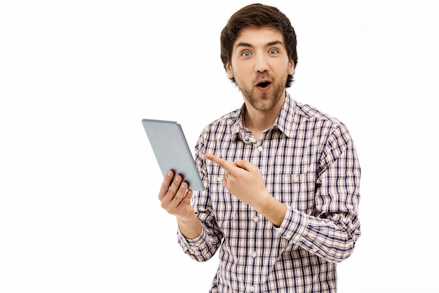 Surprised guy pointing tablet screen, say wow