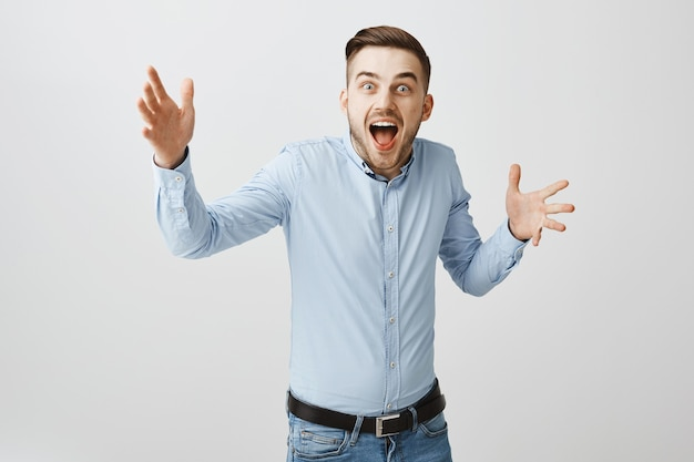 Surprised happy man realise he won, looking astounded from victory, hear awesome news