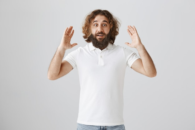 Surprised happy middle-eastern man tell big news