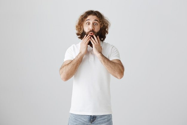 Surprised impressed middle-eastern man saying wow