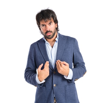 Surprised man gesture over white background
