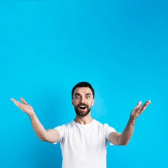 Surprised man posing with open arms