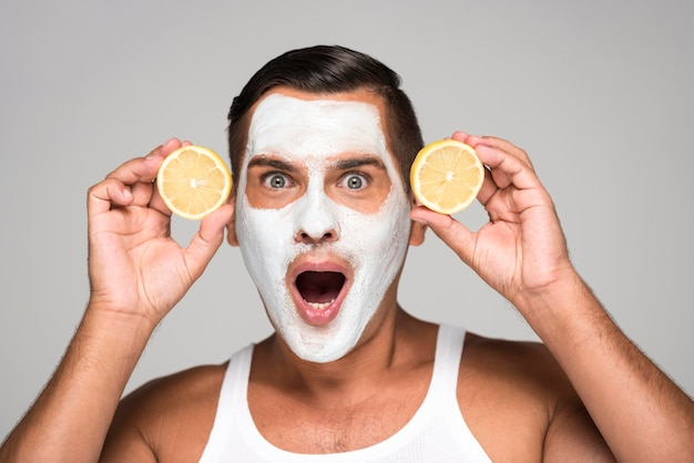 Surprised man with face mask and lemon