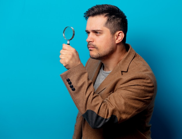 Surprised man with magnifying glass