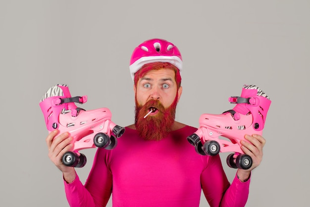 Surprised man with roller skates and helmet active sport roller skating ride healthy lifestyle