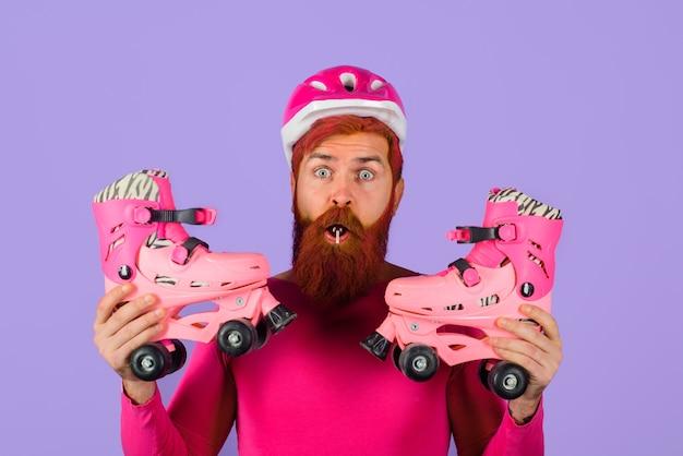 Surprised man with roller skates sport helmet active sport roller skating ride healthy lifestyle