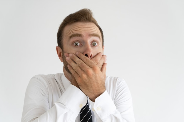 Surprised office worker deeply shocked with news.