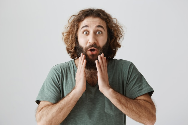Surprised rejoicing middle-eastern guy react to good news