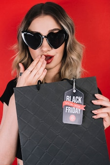 Surprised woman by offers on black friday