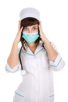 Surprised woman doctor or nurse in mask, isolated