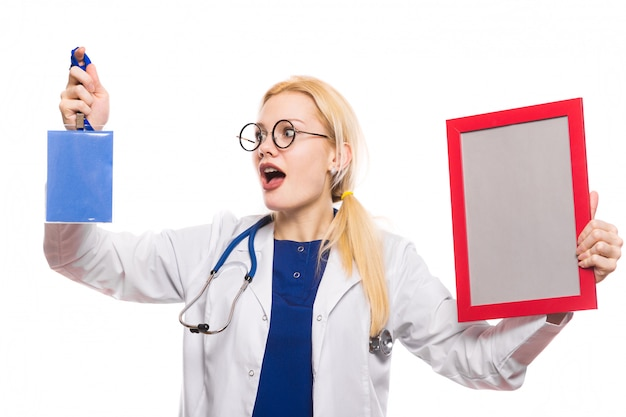 Surprised woman doctor in white coat with award