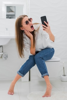 Surprised woman looking at her phone
