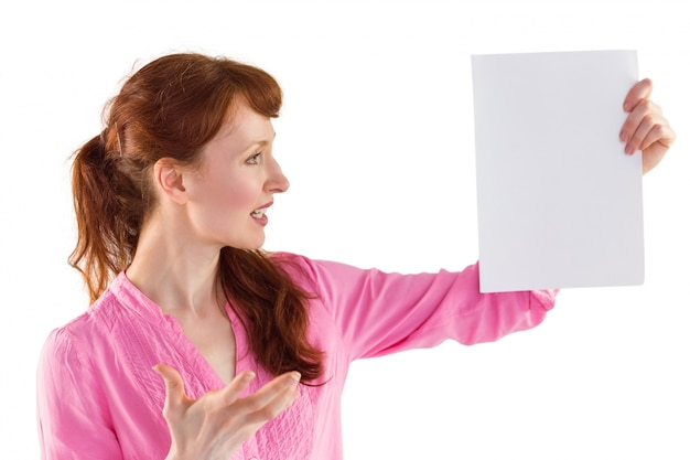 Surprised woman looking at paper