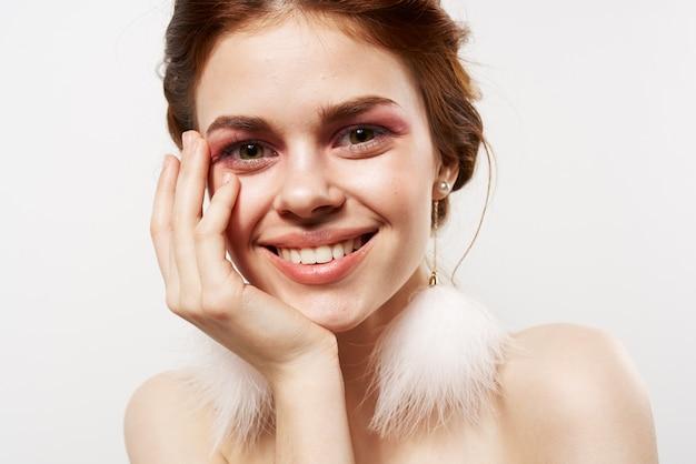 Surprised woman naked shoulders decoration makeup closeup