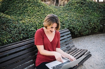 Surprised woman pointing at laptop