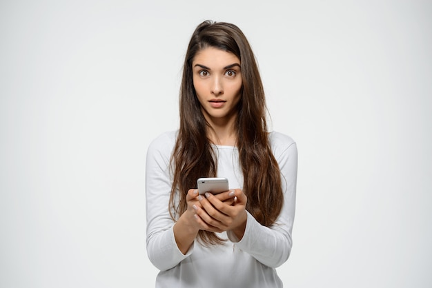 Surprised woman read strange message on phone