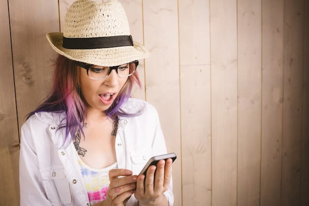 Surprised woman using mobile phone