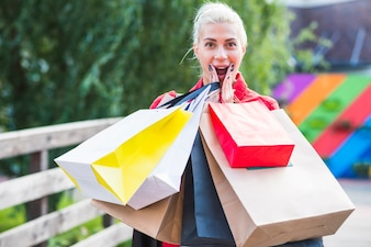 Surprised woman with shopping packets