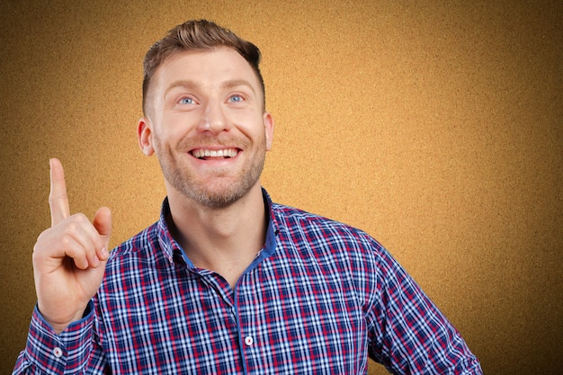 Surprised young happy man just came up with idea