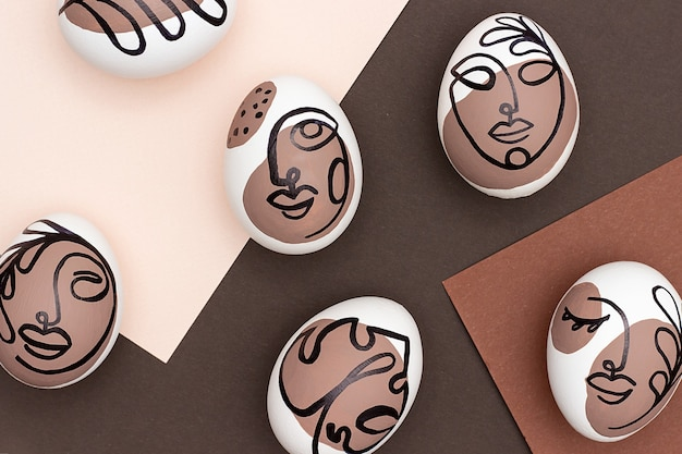 Surreal faces on eggs on brown