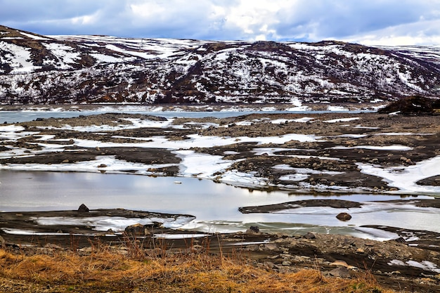 Surrealistic landscape: mountains, lake and land in scandinavia