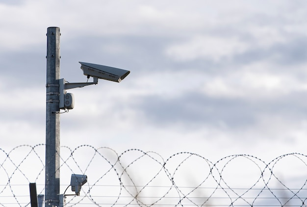 Surveillance camera and barbed wire