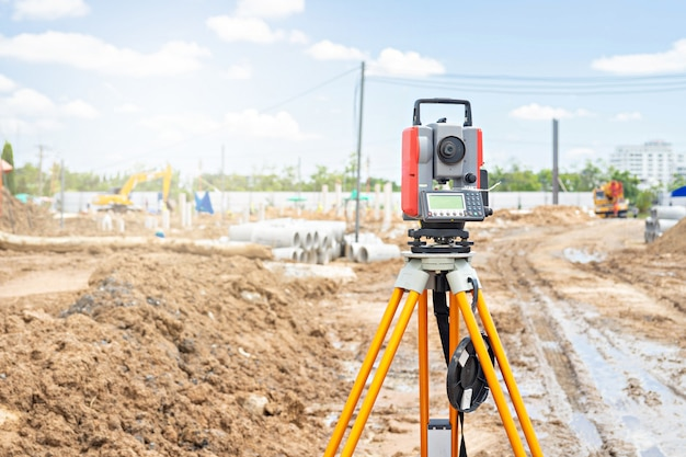 Surveyor equipment gps system or theodolite outdoors at construction site.