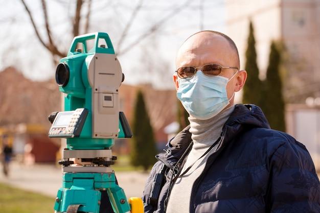 Surveyor in a protective mask, coronavirus protection concept
