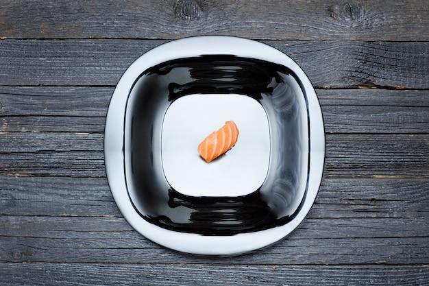 Sushi on black plate.