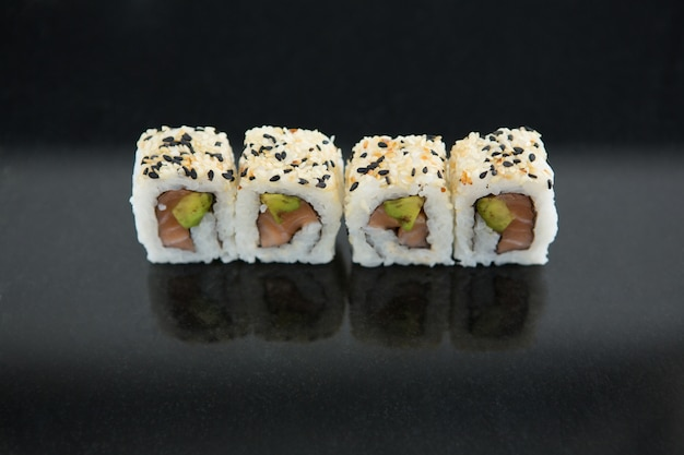 Sushi on black table
