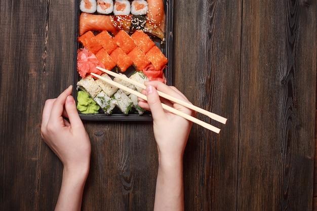Sushi chopsticks rolls snack delicacy japanese cuisine