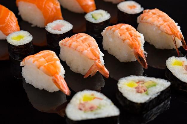 Sushi close-up, japanese food on black